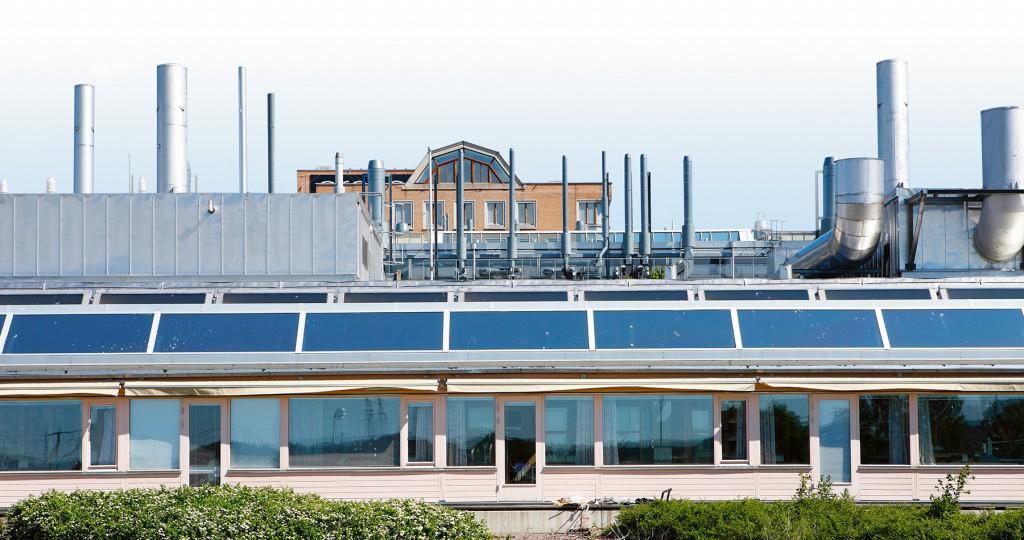 Skorsten-med-hus-1-i-bakgrund